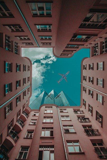 Skyscrapers Plane Buildings Urban  - deni_eliash / Pixabay